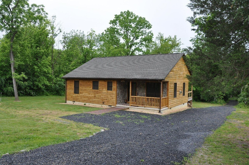 Lovely log cabin in the woods near the river