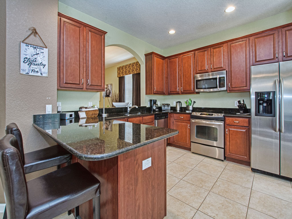 Fully equipped kitchen features granite counter tops.
