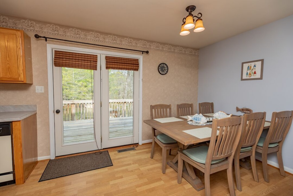 French doors to deck dining and walkway to boathouse