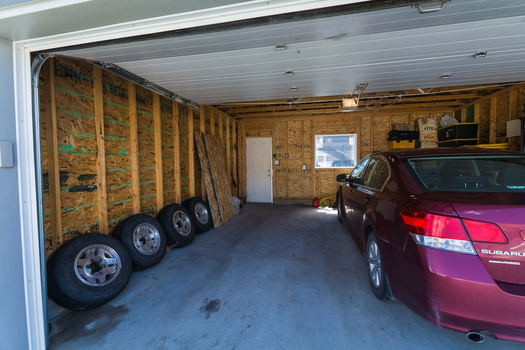 Half of the garage for parking and lockbox for keys is in garage