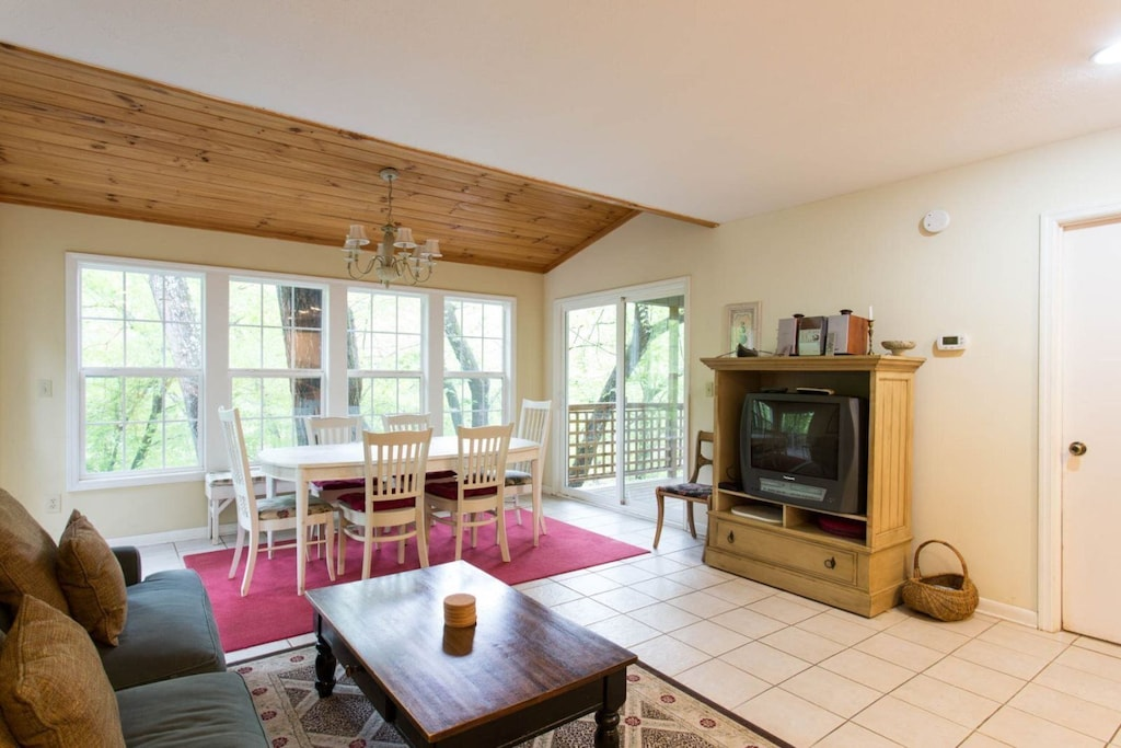 Beyond the family room area is the dining table with seating for 6. Doors here lead to the deck.