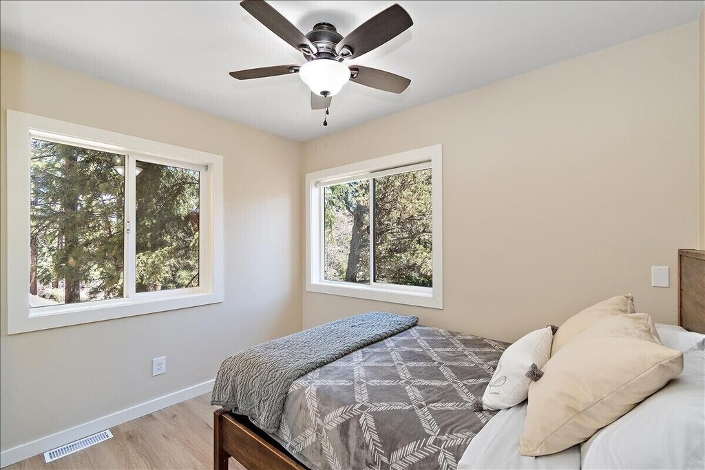 Downstairs bedroom with full bed and scenic views