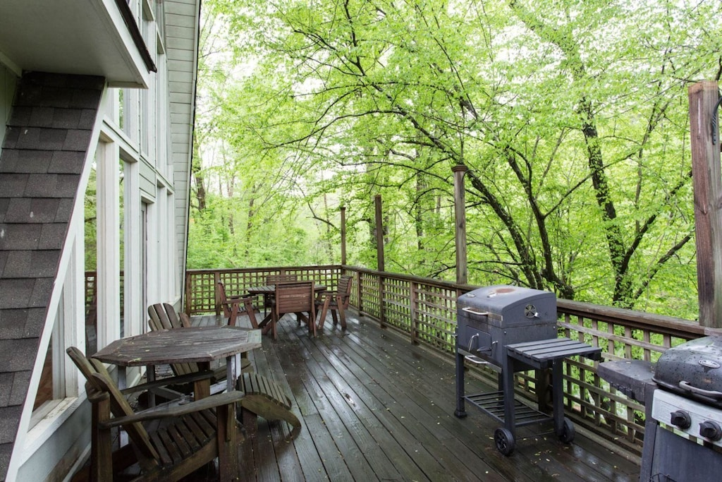 The deck offers plenty of seating options. There is a charcoal grill for your use.