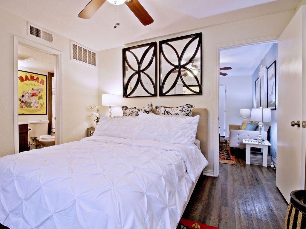 Comfortable queen bed in bedroom