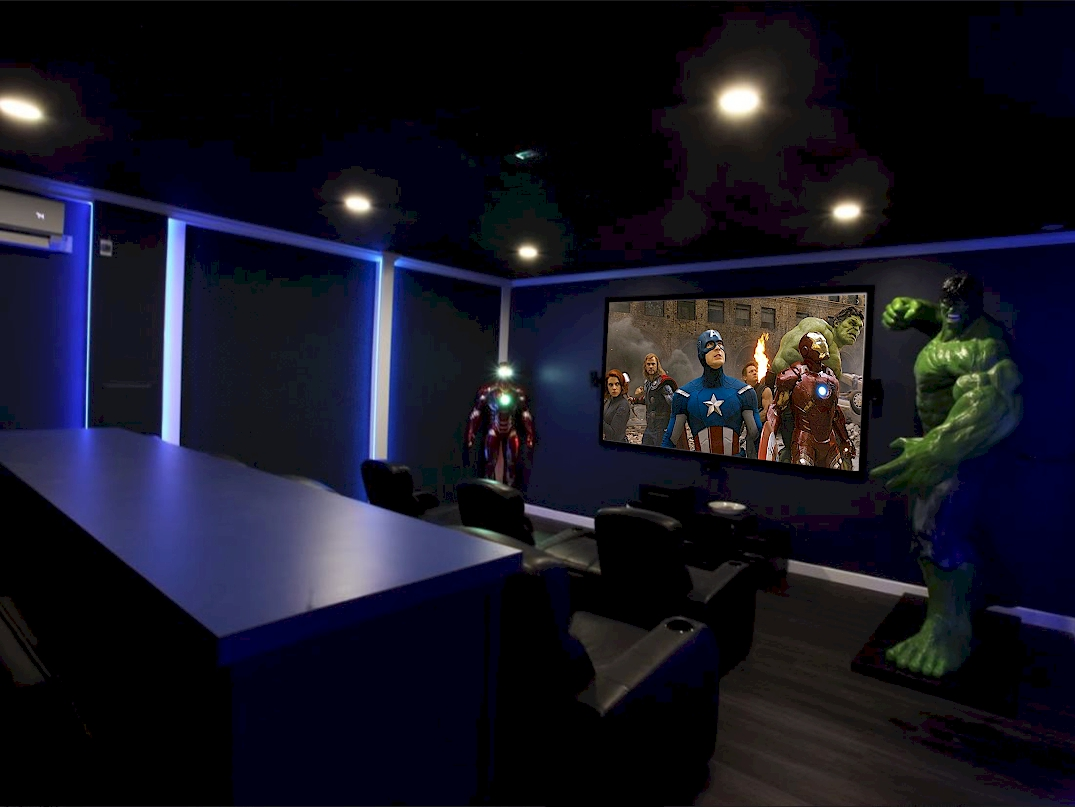 It has an indoor Movie Theater (with 8-1/2 foot Hulk & 6 foot Iron Man),