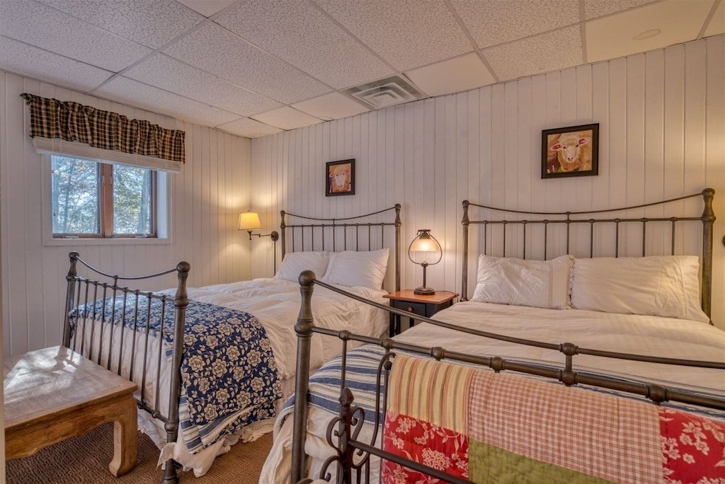 Lower level with two queen beds and a full bath