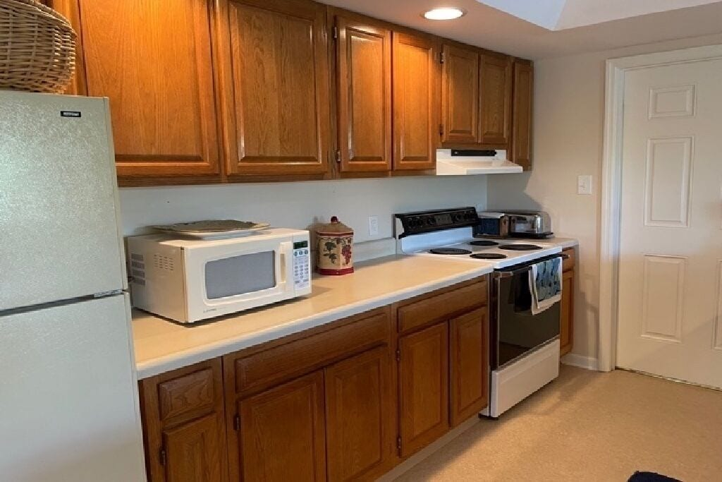 Full refrigerator, electric range and microwave