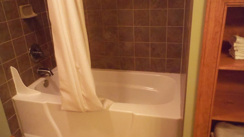 There is also a tiled shower/bathtub combination.