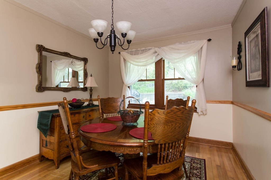 The dining table seats 4. The vintage buffet and mirror add to the ambience of this room.