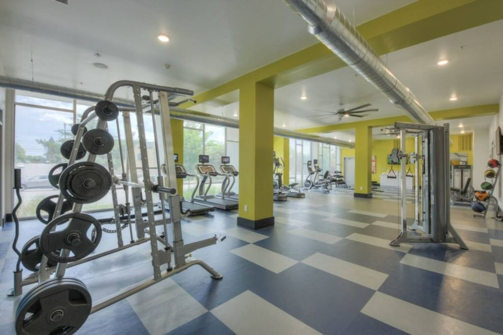 Smith machine, dumbbells, cable machine, and cardio equipment available for your use