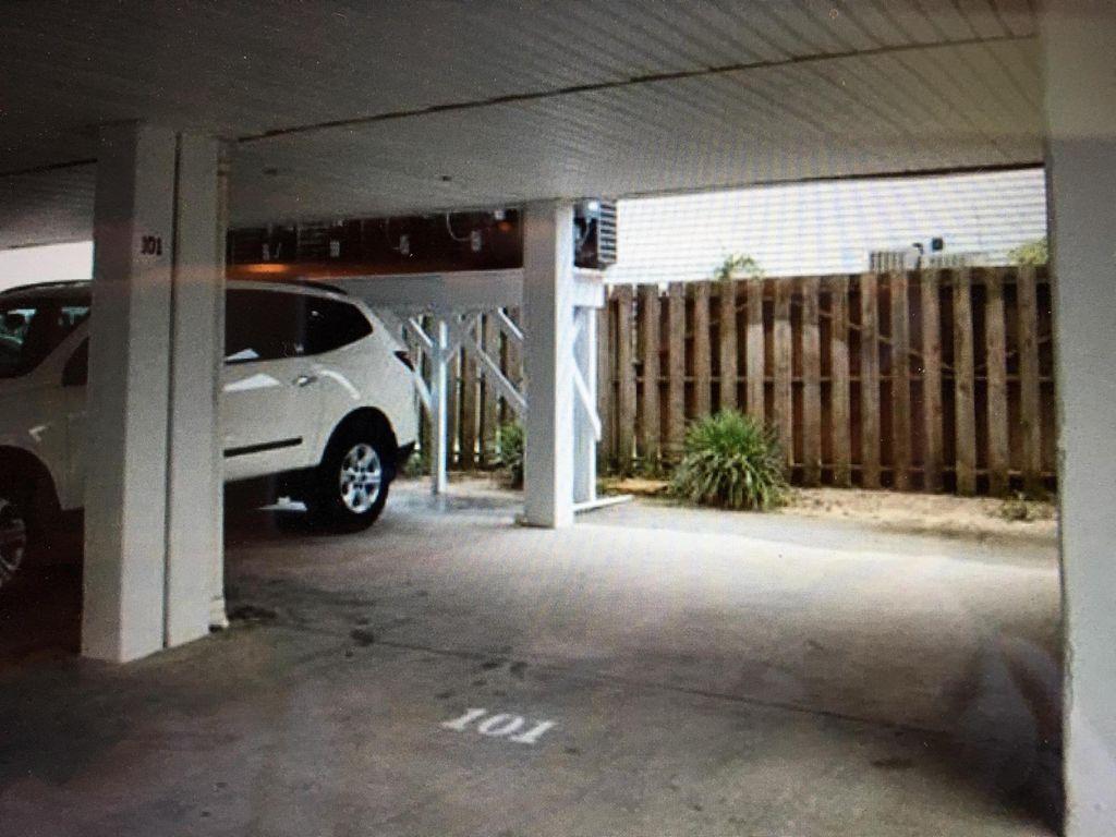"1 parking spot under building, 4 additional ""1st come 1st serve"" spots in front."