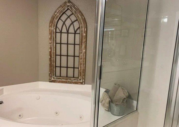 Jacuzzi tub/walk-in shower/separate water closet