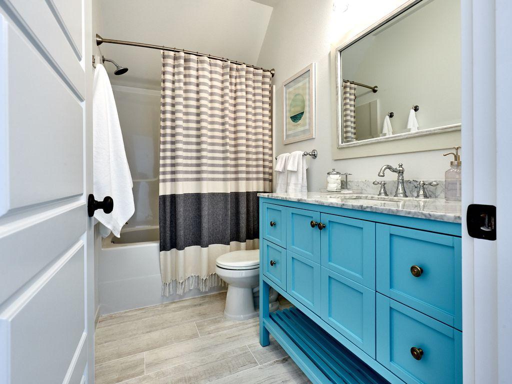 Upstairs bathroom with a bathtub.