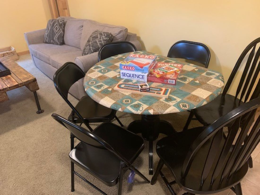 Kitchen table with seating for up to 6. Eat dinners together or play games we provide!