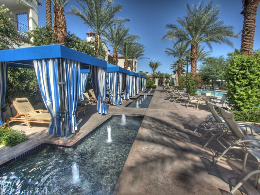 Relaxing cabanas by the pool
