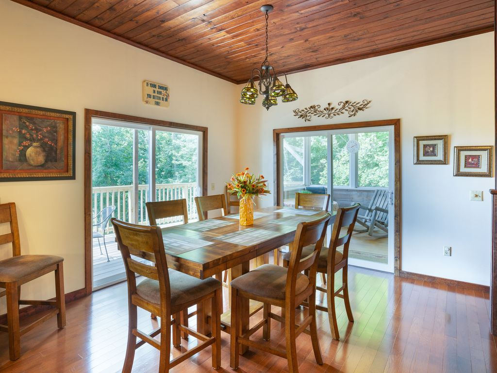 Dining table seats 8. Table has 2 leaves. Doors to deck & screen  porch.