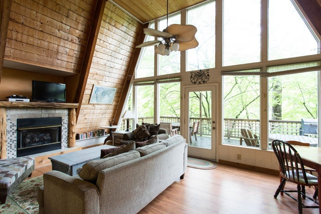 The stone fireplace and wall of windows are the focal point of this area.
