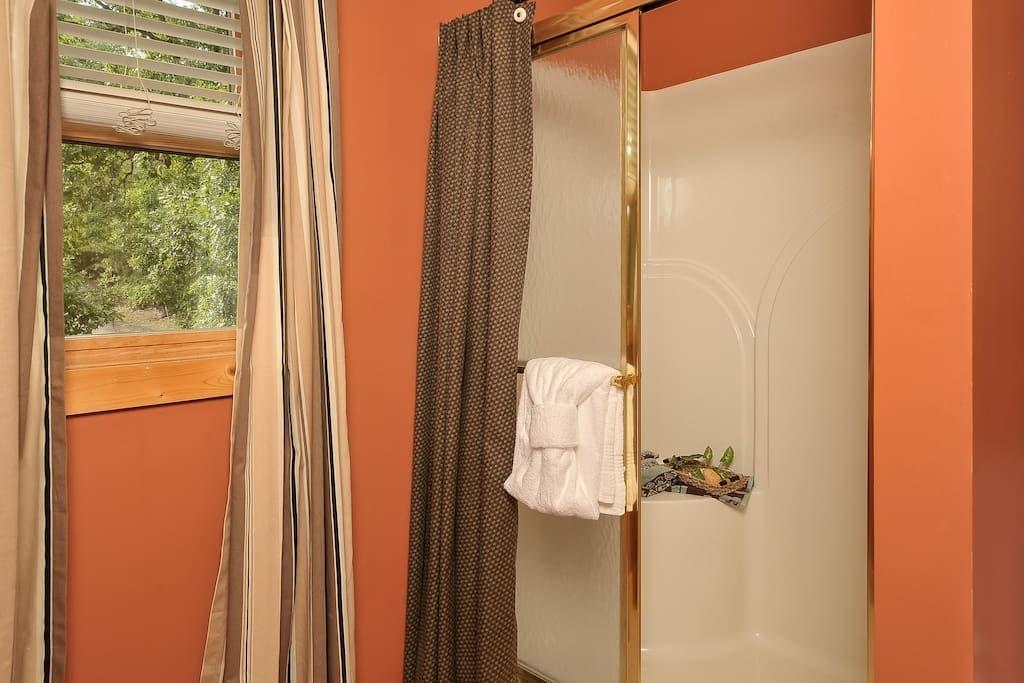 Loft bathroom shower has shower seat