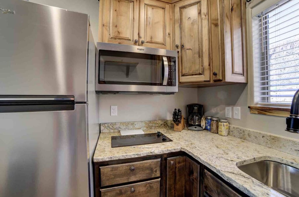 *Microwave * 2 burner cooktop (no oven)
