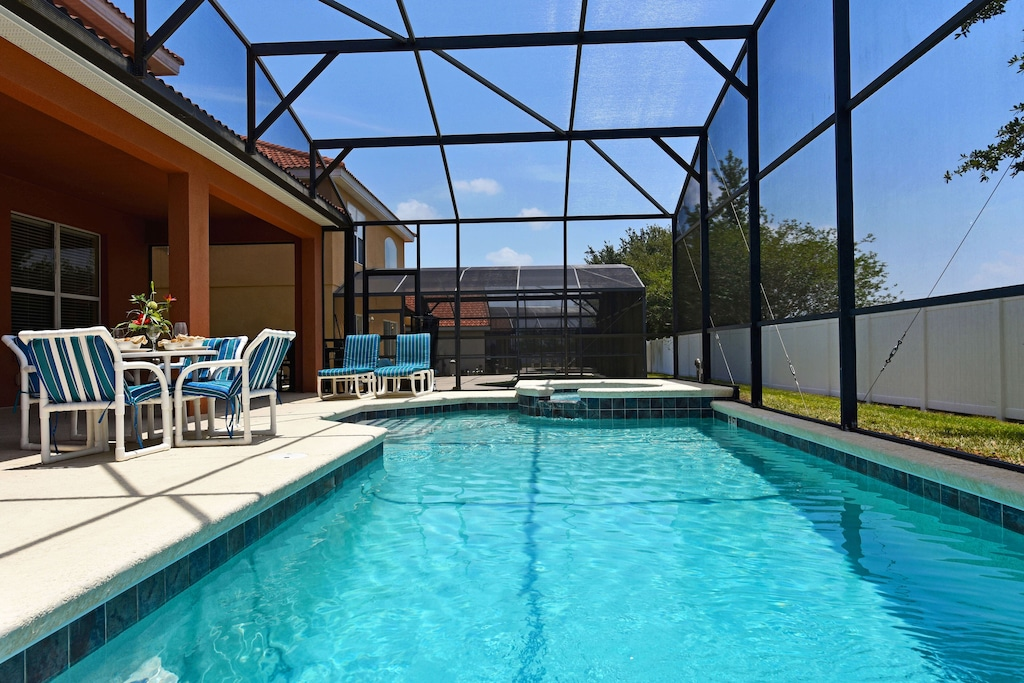 Private pool and Spa with covered lanai and child safety pool fence