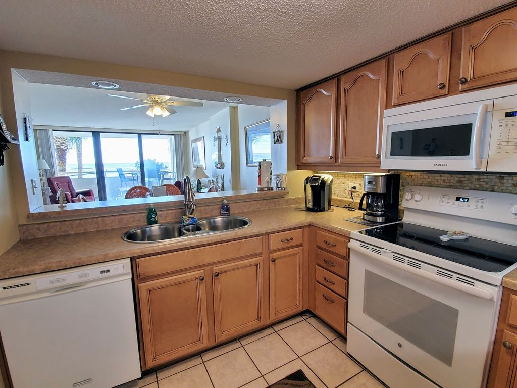 Enjoy Our Kitchen With Its Ocean Views & Appliances/Supplies Just Like Home