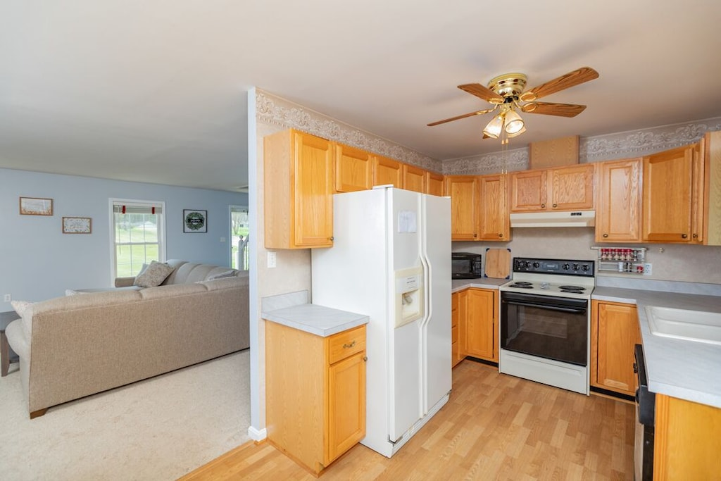 Kitchen with easy access to family room or outside deck