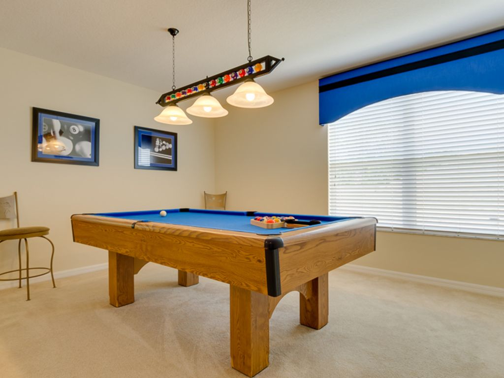 Have Fun With Your Family With This Pool Table Upstairs