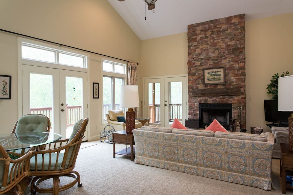 French doors in the dining and living areas provide easy access to the deck.