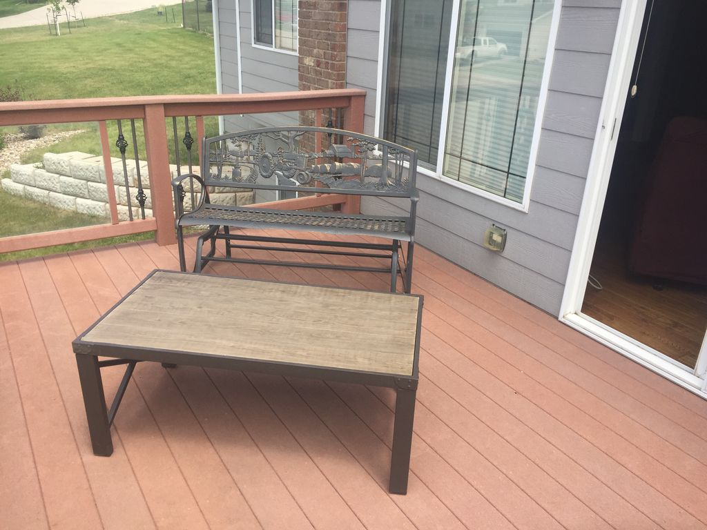 Rocker and coffee table on the deck.