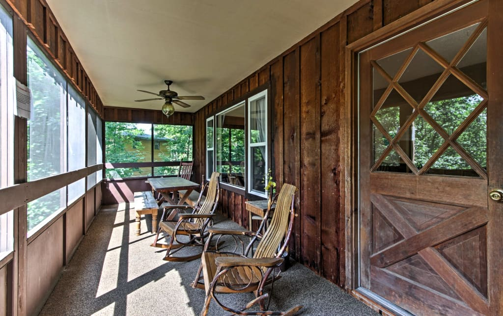 Screened-in deck with dining areas and rockers