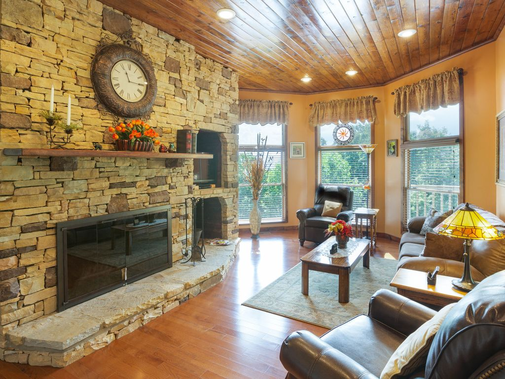 Enjoy the wood-burning fireplace in 2nd floor main living room. Comfortable seating with recliners. TV and Mountain views.