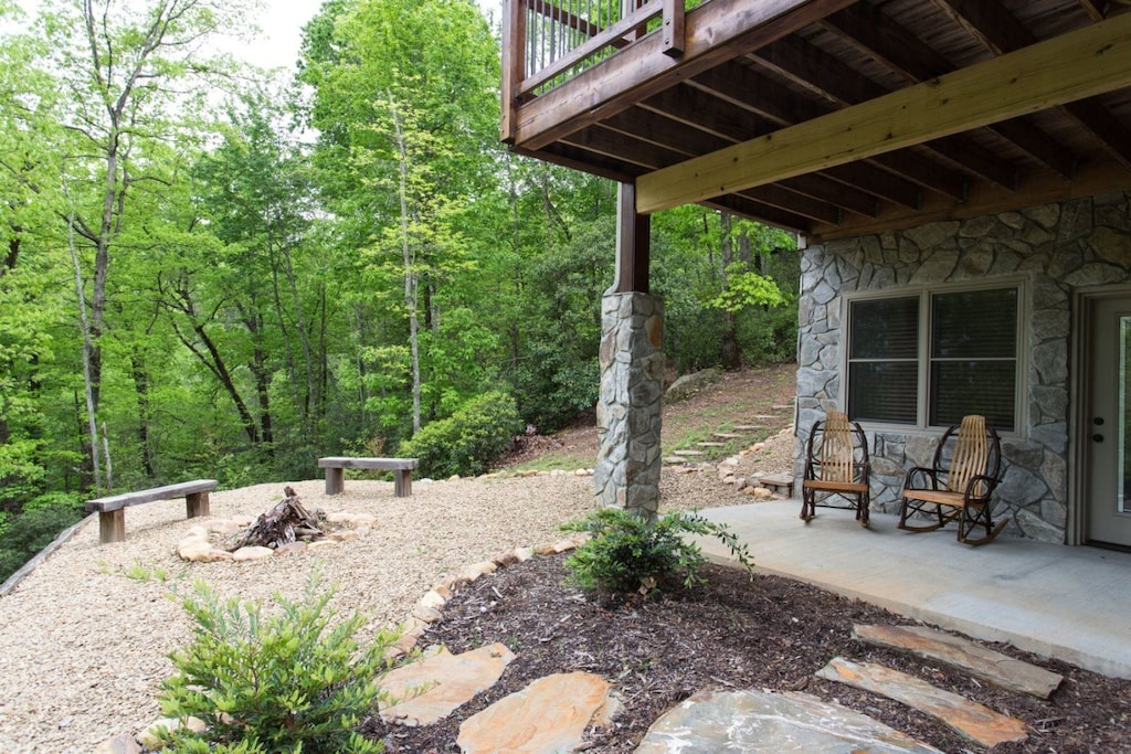 Just beyond the small covered porch is a fire pit.