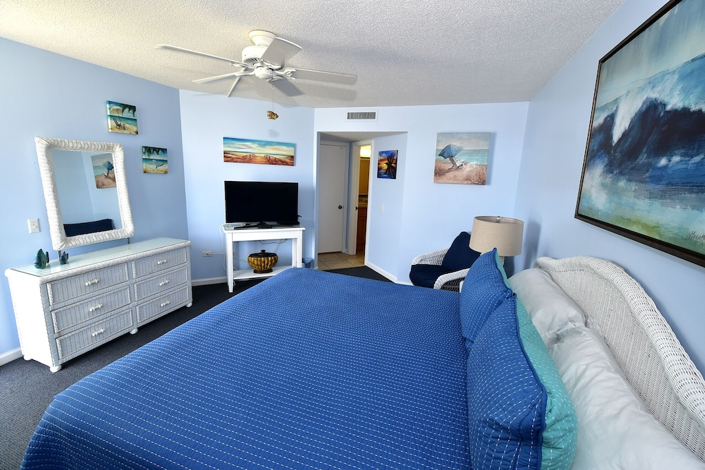 """Master Bedroom , 40"""" HDTV and Blu-Ray Player, and IHome Clock Radio Dock."""