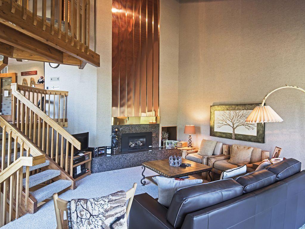 main level living room, gas fireplace, deck. TV, views of Deer Valley Resort