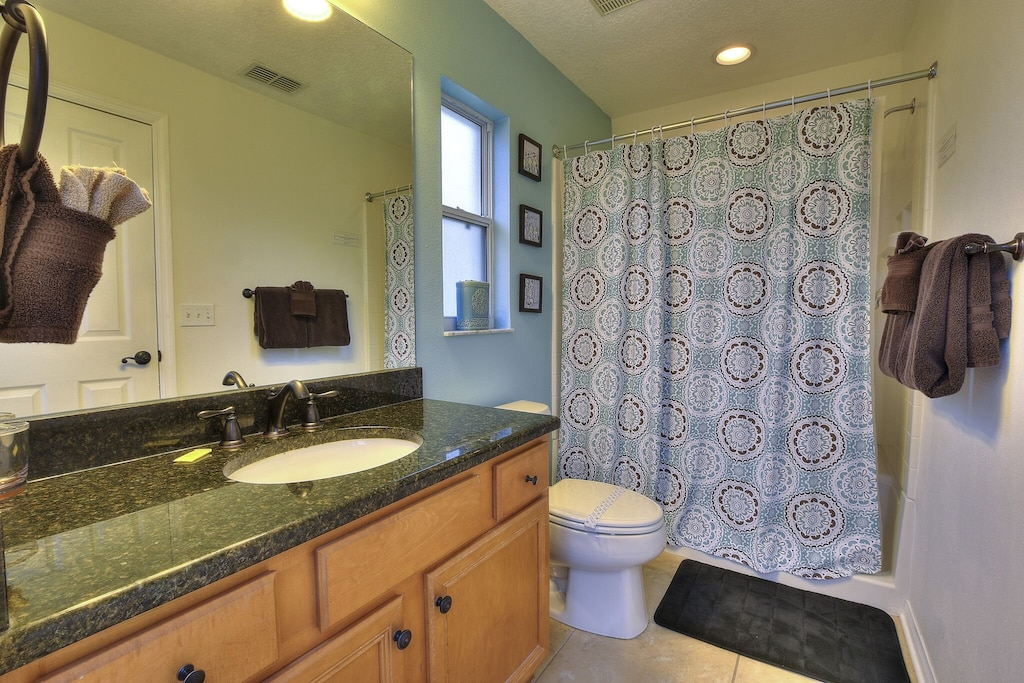 The king master bath with shower.