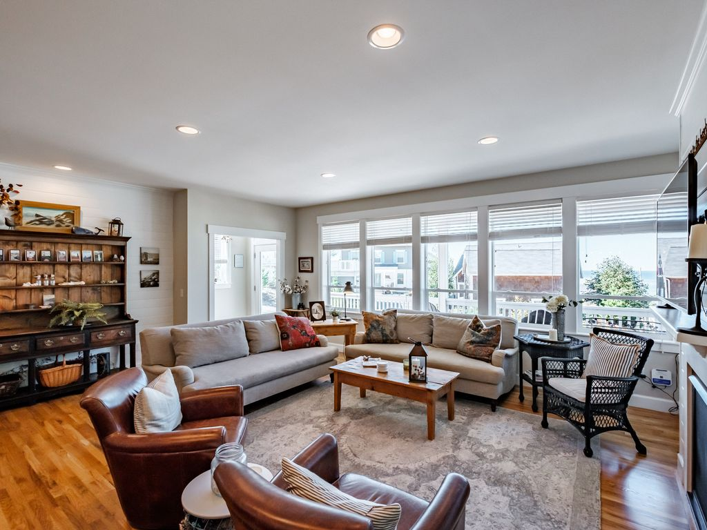 Spacious main living room is a joy to share with a large group at the beach.