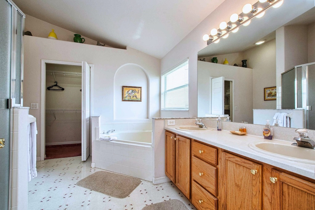 The king bath features a double sink, garden tub and walk-in closet.