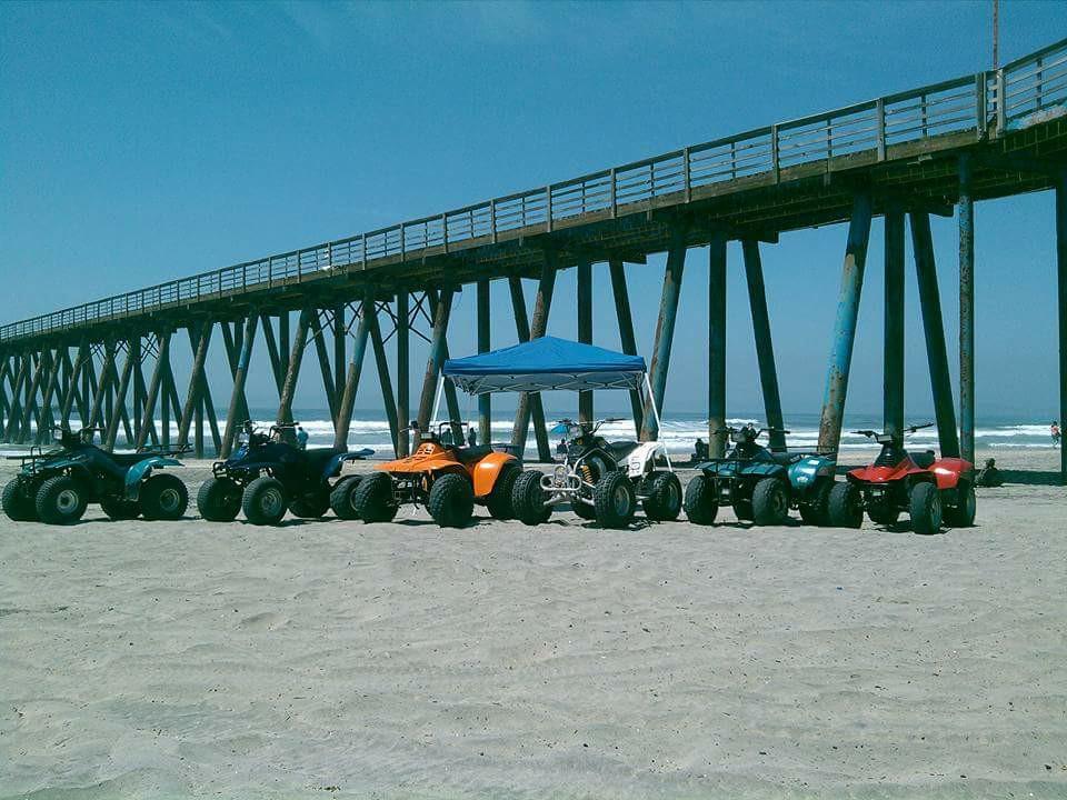 Ride ATVs on the beach