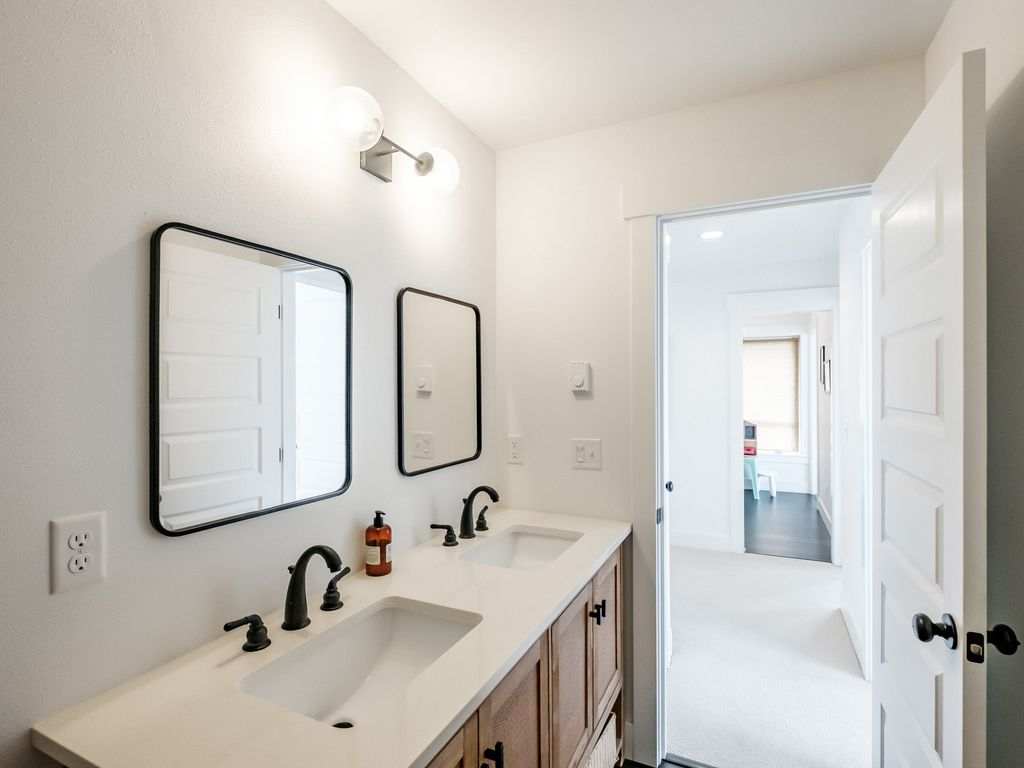 Lower level bathroom with two sinks.