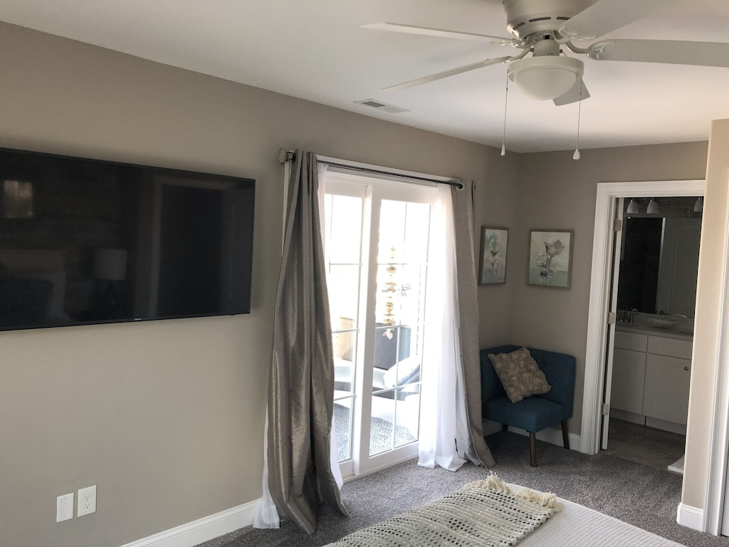 King Master Suite features a 55inch Samsung 4K TV,  balcony and bathroom