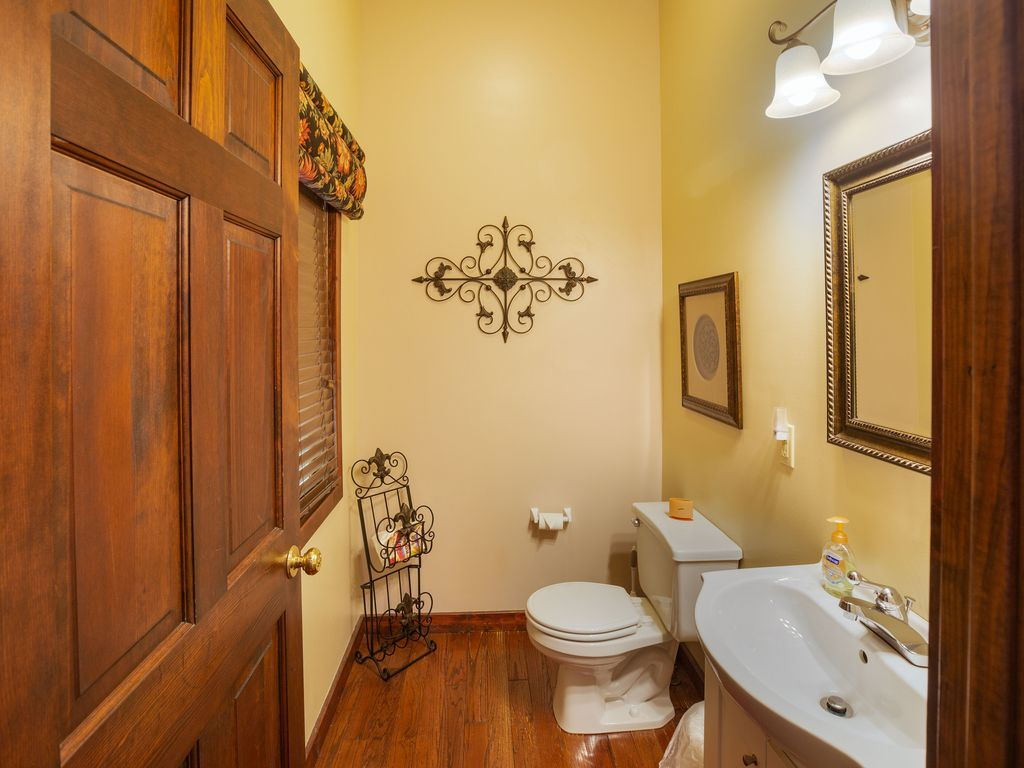 2nd floor half bath off kitchen. Each bedroom with own private bath.