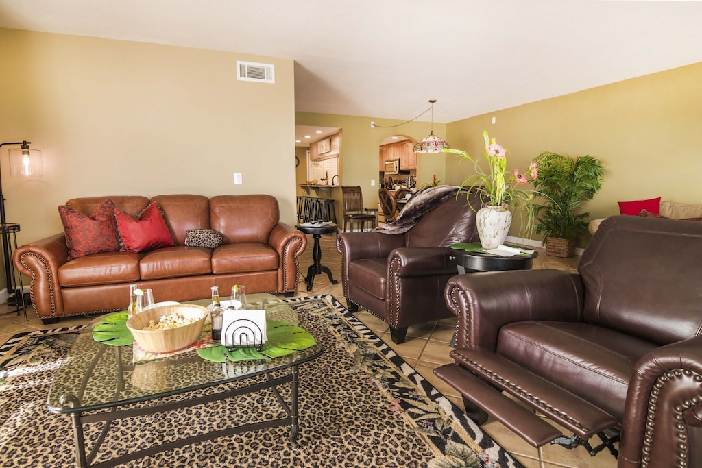 Sit Back and Relax on the  Leather Couch and Recliners.