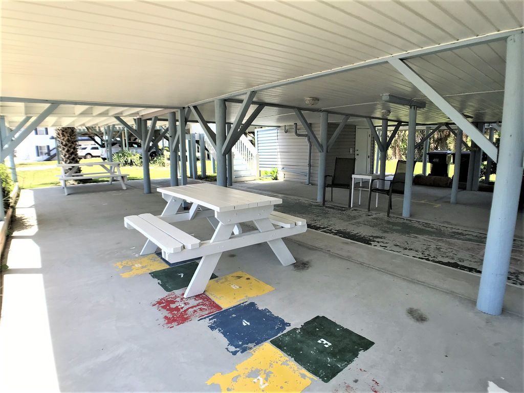 Under house with two picnic tables and more!