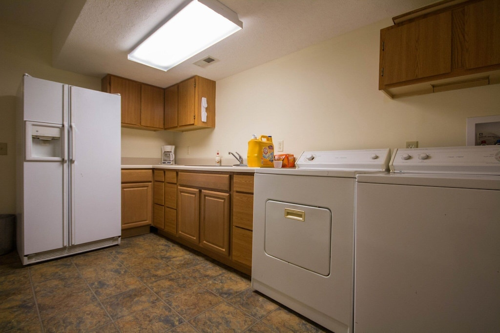The second/backup kitchen and laundry area downstairs