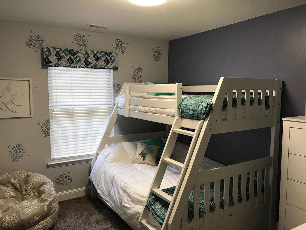 A retreat kids will love! Twin over full bunk beds with full trundle pull out!