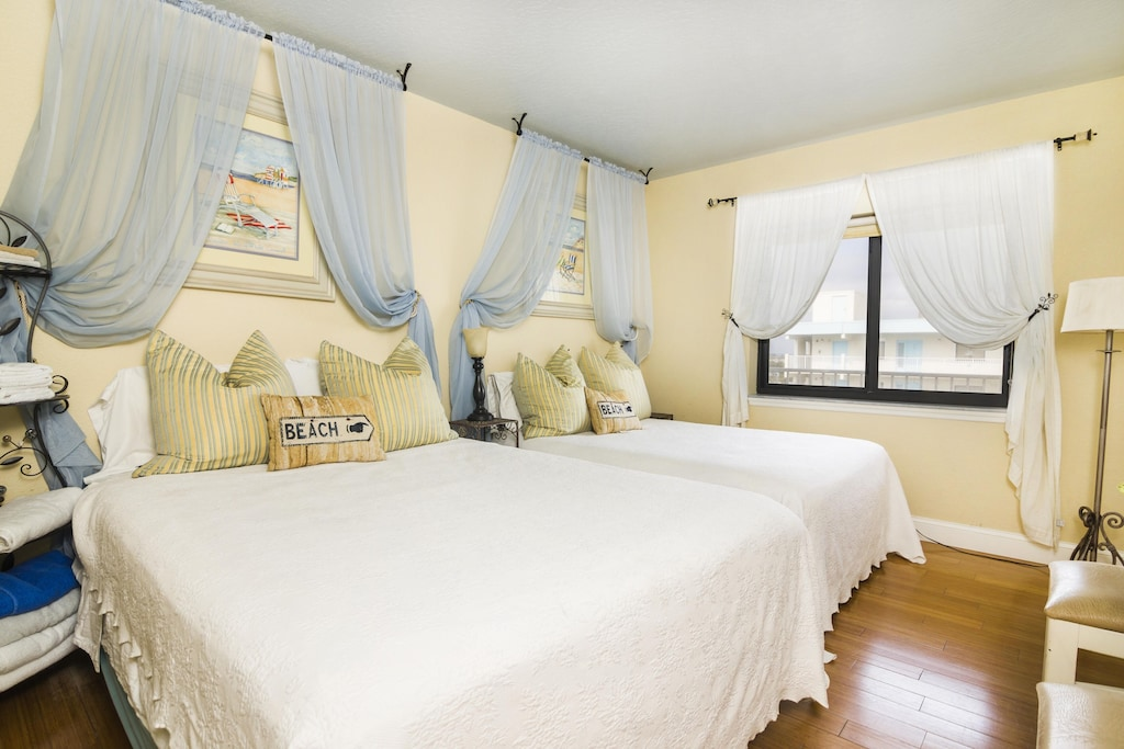 Guest Bedroom has a Pool View and Bamboo Flooring