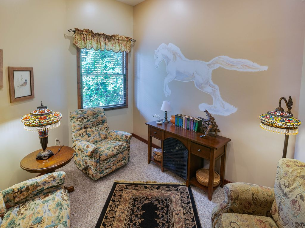 2nd floor den off kitchen. Great for reading, working on laptop or just relaxing.