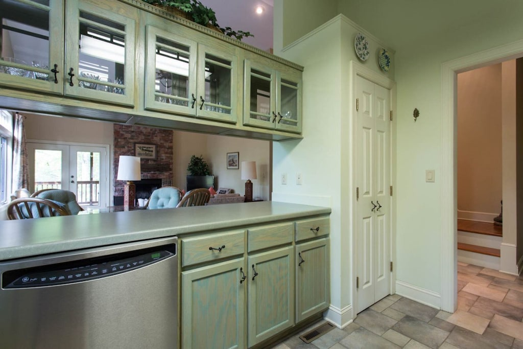 While it is not completely open to the dining and living areas, there is an open space between the counter and glass-door overhead cabinets.