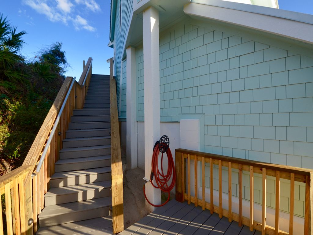 North stairwell is well lit, aluminum handrails for safety, and goes to porch.