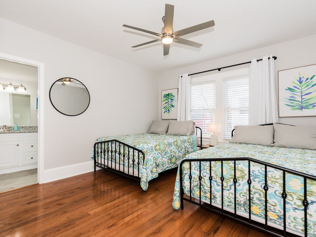 2 Queen beds, duel closets, on-suite full bathroom, blinds & blackout curtains.